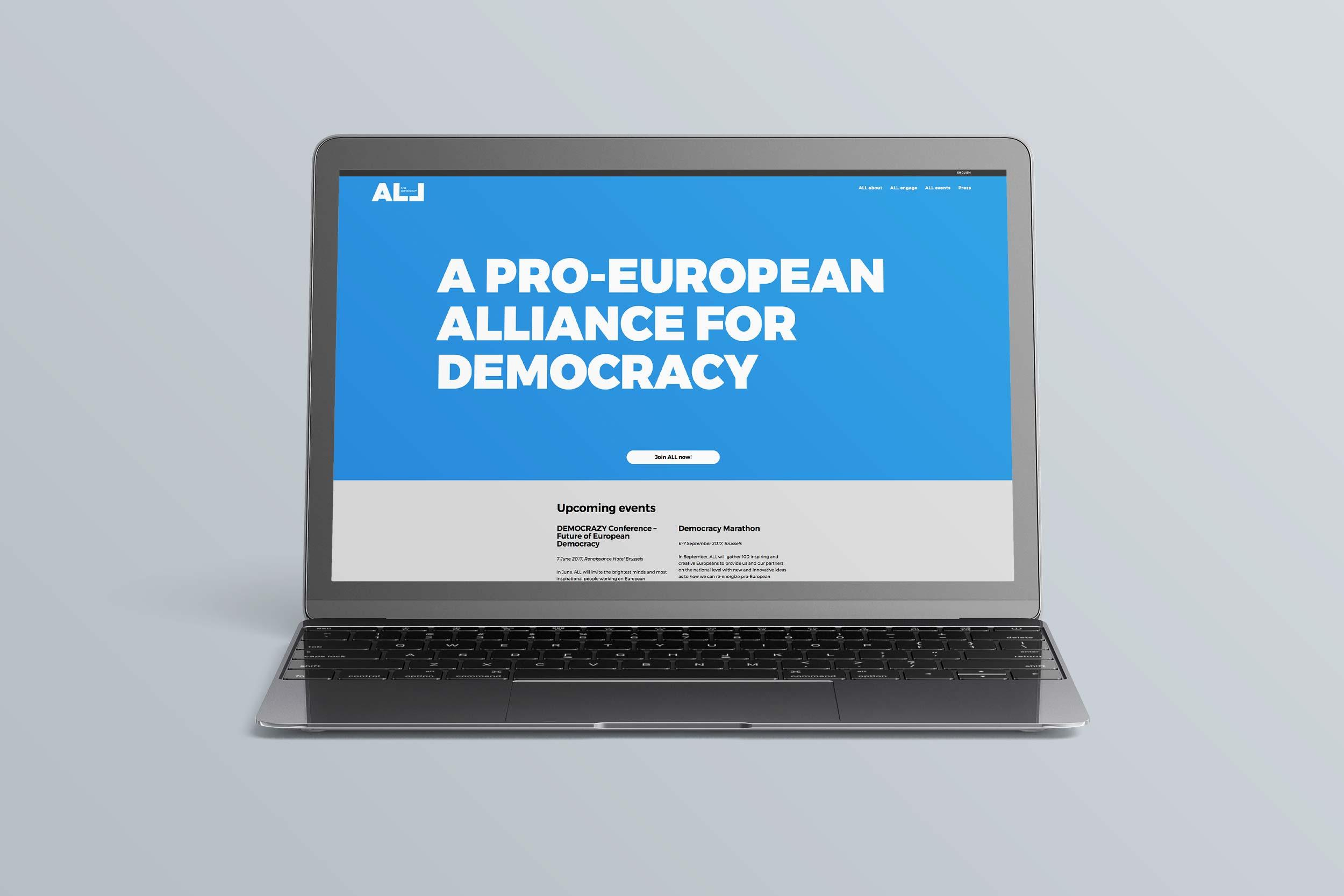 All for Democracy website frontpage on a laptop